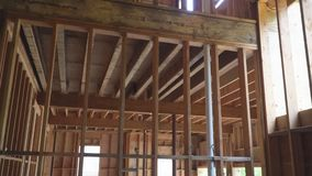 New building unfinished outside the wood frame and beam construction. Unfinished building outside the wood frame and beam construction stock video footage