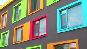 New building with varicoloured windows. New building with many-coloured windows stock video