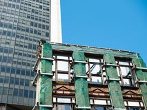 New building versus old building demolition royalty free stock photos