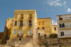 New buildings in Chania are built on the foundations of old yellow brick buildings royalty free stock photo