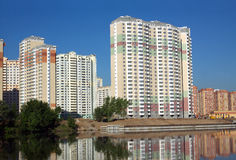 New buildings over river and clear blue sky in summer day Stock Photo