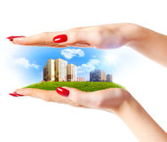 New buildings in woman hands Stock Image