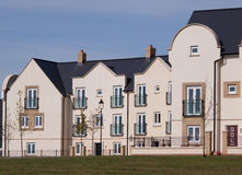 New Built Houses. Recently built houses with varying styles overlooking a green field Royalty Free Stock Photography