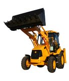 The new bulldozer of yellow color with the lifted bucket Stock Photo