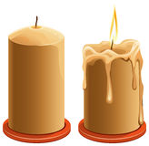 New and burning wax candle Stock Photos