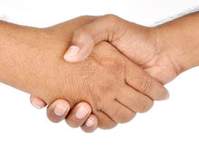 NEW BUSINESS AGREEMENT. Two hands shaking for new business agreement Royalty Free Stock Photos