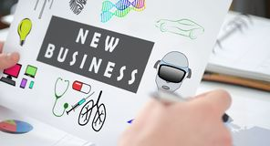 New business concept on a paper. Hands holding a paper showing a new business concept stock photos
