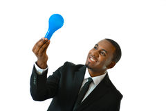 New Business Idea. Business man holding up a light bulb representing new business idea concept Royalty Free Stock Image