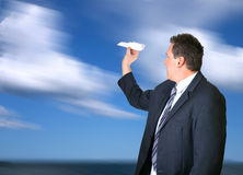 New Business Ideas. Man holding a paper plane outdoors. Concept for  new business ideas Stock Image
