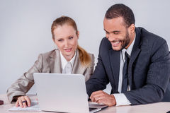 New business objectives. Two smiling businessman looking at lapt Stock Photo