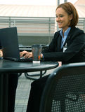 New Businesswoman. Shot of business woman showing happy expression and working on her laptop stock photography