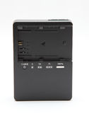New camera battery charger Royalty Free Stock Photography