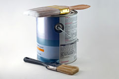 New can of paint and two brush sizes Stock Photography