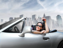 New car. Smiling beautiful woman sitting in a car Royalty Free Stock Images