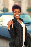 New car. African American businesswoman happy with keys to new car Royalty Free Stock Photo