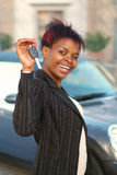 New car. African American businesswoman happy with keys to new car Stock Image