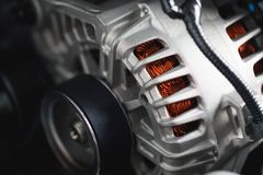 New car alternator. Close-up view stock images