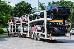 New car on big trailer, delivery shipment. Of transportati royalty free stock photo