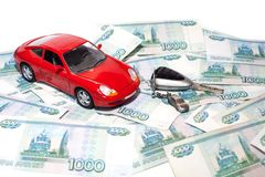 New car Concept - Key and a red car with banknotes royalty free stock image