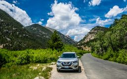 New car crossover on a mountain road. Summer family travel to the USA. Estes Park, Colorado / USA - June 29 2017: cars on the highway in the vicinity of the Stock Images