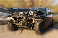 New car damaged in an accident. Black new car damaged in an accident Royalty Free Stock Image
