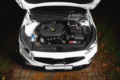 New car engine and parts under hood bonnet. Top view royalty free stock photo