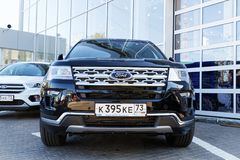 New car Ford Explorer. Ulyanovsk, Russia - September 23, 2018: New car Ford Explorer - exhibition car stands in front of the Ford car selling and service center royalty free stock photos