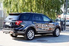 New car Ford Explorer. Ulyanovsk, Russia - September 23, 2018: New car Ford Explorer - exhibition car stands in front of the Ford car selling and service center stock photos