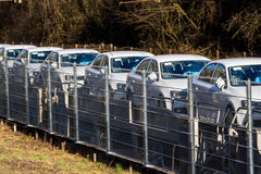 New car on a freight train. A freight train brings new cars to car dealers stock image