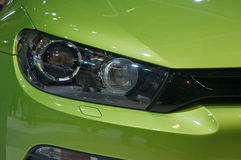 New car - headlight. Detail of a new car at the motor show Royalty Free Stock Photography