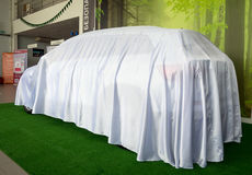 New car hidden under the cover before the premiere. Voronezh, Russia - June 04, 2017: New car hidden under the cover before the premiere Stock Images