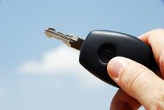 New car key. Hand holding new car key against a sky Stock Photos