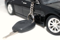 New car key. Car key and vehicle on the white background Royalty Free Stock Photo