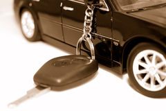 New car key. Car key and vehicle on the white background Royalty Free Stock Photography