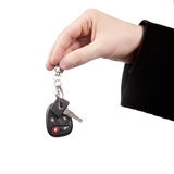 New car keys. New car concept - hand and keys isolated on white stock photography