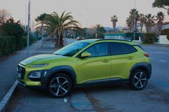 New car or off-road vehicle in green or acid yellow. parked on the street royalty free stock photography