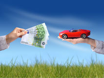 New car owner concept. Buying new sport car concept. Hand with money and car on the image stock images