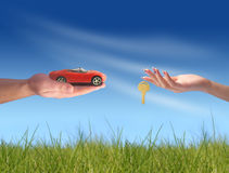 New car owner concept. Buying new sport car concept. Hand with key and car on the image stock images