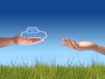 New car owner concept. Buying new sport car concept. Hand with key and car on the image royalty free stock photography