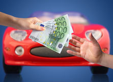 New car owner concept. Buying new sport car concept. Hands with money and car on the image royalty free stock photo