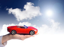 New car owner concept. Buying new sport car concept. Hand holding new red sport car royalty free stock photo