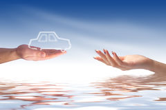 New car owner concept. Buying new car concept. Hand giving car to other hand royalty free stock photography