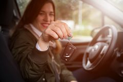 New car owner - female driver with keys stock photography