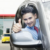 New car owner shows thumb up Stock Image