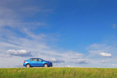 New car parked by the side of a lonely road in rural Royalty Free Stock Photos
