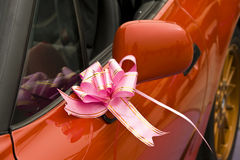 New car with pink bow Royalty Free Stock Photos