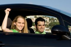 New car, rental or hire. Couple with new car rental or hire royalty free stock photography