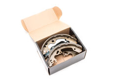 New car`s break shoes kit in the box on the white background Stock Image