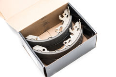 New car`s break shoes kit in the box on the white background Stock Images