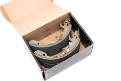 New car`s break shoes kit in the box on the white background Royalty Free Stock Photo
